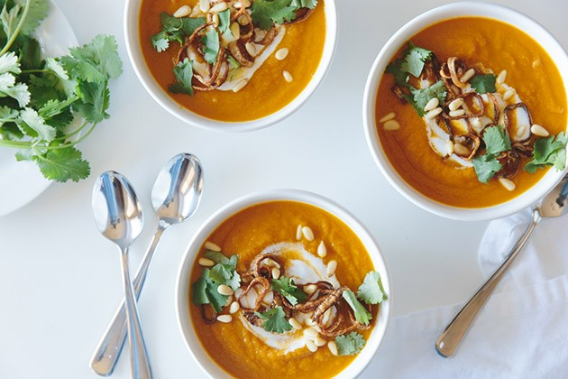 16- CARROT GINGER SOUP WITH CRISPY SHALLOTS AND COCONUT CREAM