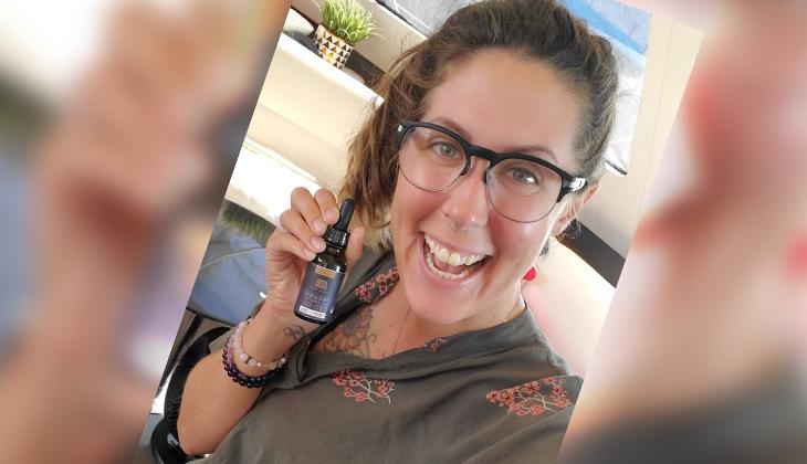 Leanne Vogel with CBD bottle