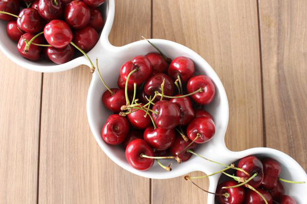 Bowls filled with red cherries