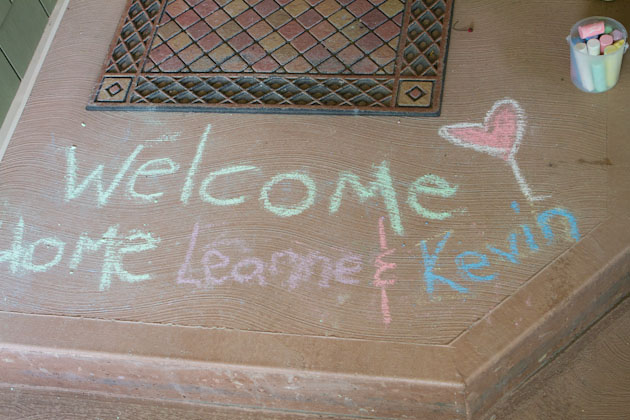 Welcome home chalk writing on door steps