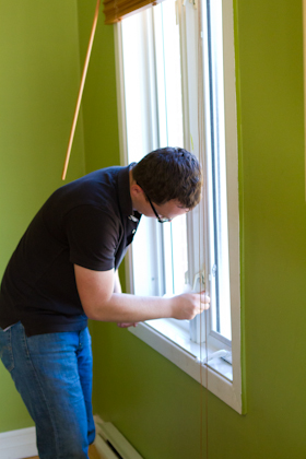Kevin Kraft sanding windows in Montreal