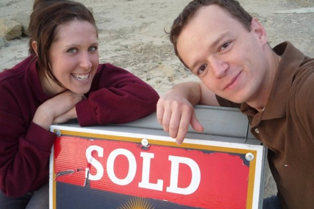 Leanne and Kevin with sold sign